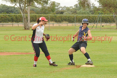 Tyson Renshaw (Lox Blue) on 2nd base as  Taylee Healy (Berri) watches his foot on the bag