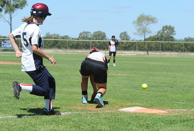 Thalia Boatswain (Waikerie) fumbles the ball on  1st base as Berri runner comes in.