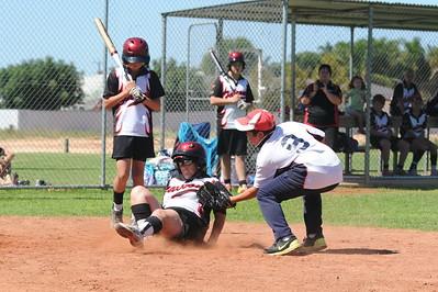 Austin Karpany (Berri) tags out Hayley Kuchel (Waikerie) at home plate
