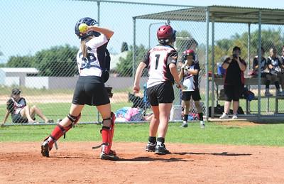 Emma Pillion (Waikerie) turns as Sarah Armstrong (Berri0 prepares to throw to 3rd base.