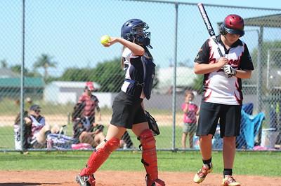 Sarah Armstrong (Berri) catcher Brayden Murray (Waikerie) at bat