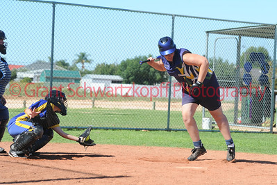 Kellie Holland (Loxton ) jumps out of the way as  Naomi Taylor (Cobby) takes the ball