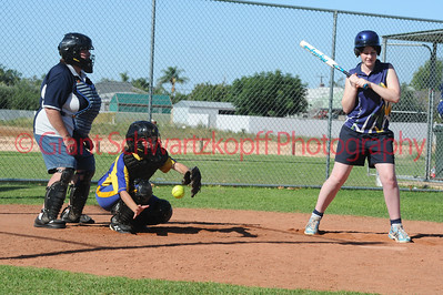 Amy Lidgerwood (Loxton) lets the ball sail through to the catcher, Naomi Taylor (Cobby)
