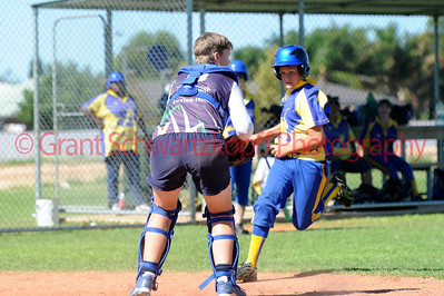 Hayley Symens (Loxton) tags out Cobby runner(Kris Taylor) at home plate