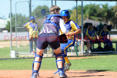 Hayley Symens (Loxton) tags out Cobby runner (Kris Taylor) at home plate