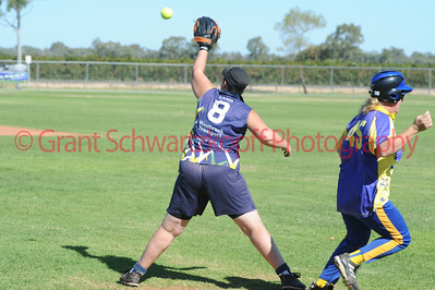 Jo Gregory (Cobby) touches 1st base just before the ball hits the glove of Kellie Holland (Loxton)