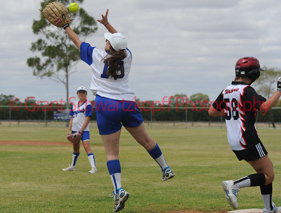 Amanda Yia (Renmark) stretches for the ball on 1st base as Haylee Campbell (Waikerie) runs past.