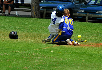 Amy Selfe (Renmark) collides with Andrew Sewell (Cobby) on home plate