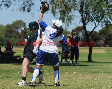 Kane Thompson (Loxton Green) safe at home while Amy Selfe (Renmark) waits to take the ball.