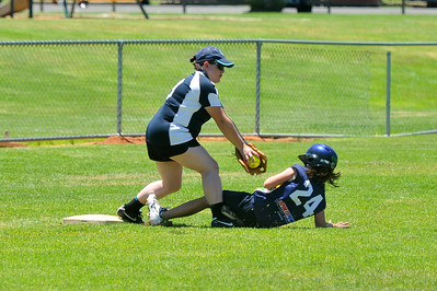 Cody Hammerstein (Lox Blue) safe at 3rd base as Terri Miller (Lox Green) tries to tag