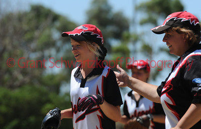Hayley Kuchel (Waikerie) gets a pat on the back from Kristy Smith (Waikerie)  after taking a great outfield catch