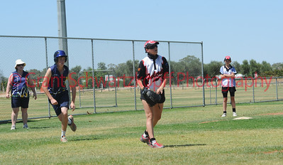 Kristen Pick (Waikerie) waits for ball as Tyson Renshaw (Loxton) gets ready to steal home.