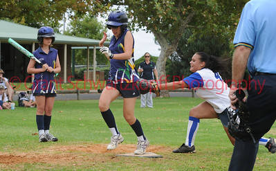Kailey Waechter (Lox Green) crosses home plate and is tagged by Amy Selfe (Renmark)