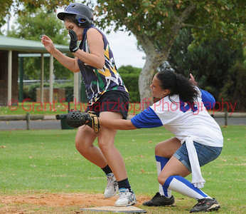 Renee Brown (Lox Green) crosses home plate and is tagged by Amy Selfe (Renmark)