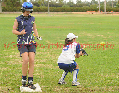 Mikayla Hammerstein (Lox Green) safely on 3rd base as the ball come in to Leanne Le (Renmark)