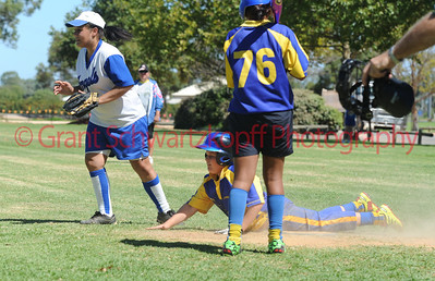 Andrew Sewell (Cobby) slides into home plate as Amy Selfe (Renmark) waits for ball