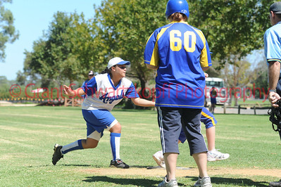 Amy Selfe (Renmark) tags the Cobby runner out at home plate