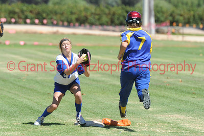 Kayla Wyatt (Renmark) has the ball safely in her glove before Jade Pech (Cobby) can touch 1st base