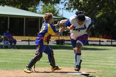 Amy Selfe (Renmark) runs home to score a home run. Andrew Sewell (Cobby) waits for ball