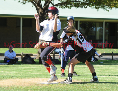Helen Johnson (Waikerie) tags out runner Steph Lacey (Berri)at home plate.