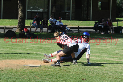 Kelly Ainsley (Berri) slides in to home plate only to be tagged out by Helen Johnson (Waikerie)