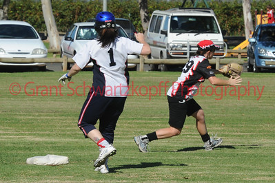Sarah Kuchel (Waikerie) takes the ball at 2nd base as Kelly Ainsley (Berri)  strides to the base.