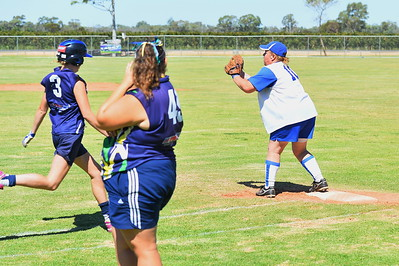 Leane Jones (Renmark) makes the out at 1st as Emmie Richardson (Loxton) tries to beat the throw