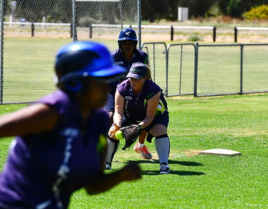 Michelle Bradtke (Loxton) fielding on 3rd as Kathy Johnson ( Loxton Green( gets ready to steal home