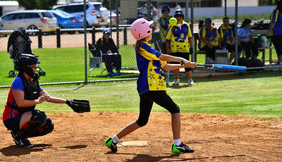 Ebonee Pech (Cobby) at bat with Lara Brauer (Lyrup) catching