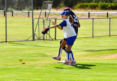 Sienna Hentscke (Renmark) tries for the out at 3rd