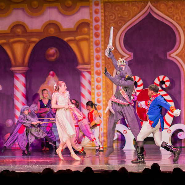 The Nutcracker Prince preparing to kill the Mouse King while Clara Haylie Jarvis watches.
