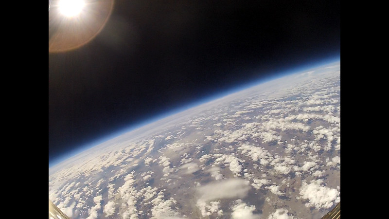 Curvature of the earth with the sun in the distance