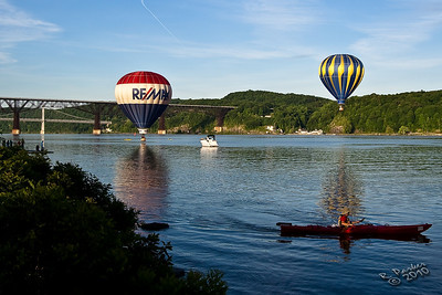 Balloons hovering over the Hudson River at the Dutchess County balloon festival