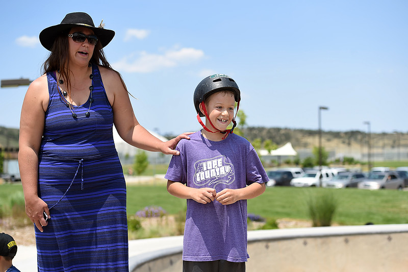 Kaden Myers, 8, right, and Emily Krawczuk, left, Gavin Myers' little brother and aunt, tell a funny story about Gavin after friends and family released balloons in his memory Monday, July 2, 2018, at the skate park at Mehaffey Park in Loveland. Gavin, a 13 year-old who was killed when he was struck by a pick-up truck on June 8, spent countless hours at the skate park scootering with his friends.  (Photo by Jenny Sparks/Loveland Reporter-Herald)