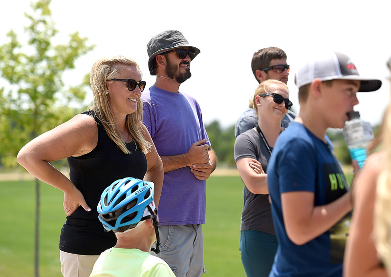 Melissa Myers, left, and Eric Myers, center, parents of Gavin Myers, listen as friends share stories about Gavin after friends and family released balloons in his memory Monday, July 2, 2018, at the skate park at Mehaffey Park in Loveland. Gavin, a 13 year-old who was killed when he was struck by a pick-up truck on June 8, spent countless hours at the skate park scootering with his friends.  (Photo by Jenny Sparks/Loveland Reporter-Herald)