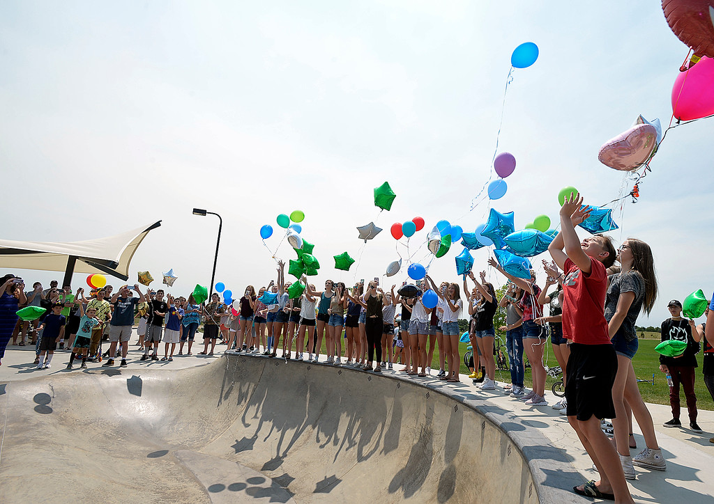 . Payton Brown, 13, far right, and a group of Gavin Myers\' friends and family release balloons in his memory Monday, July 2, 2018, at the skate park at Mehaffey Park in Loveland. Gavin, a 13 year-old who was killed when he was struck by a pick-up truck on June 8, spent countless hours at the skate park scootering with his friends.  (Photo by Jenny Sparks/Loveland Reporter-Herald)