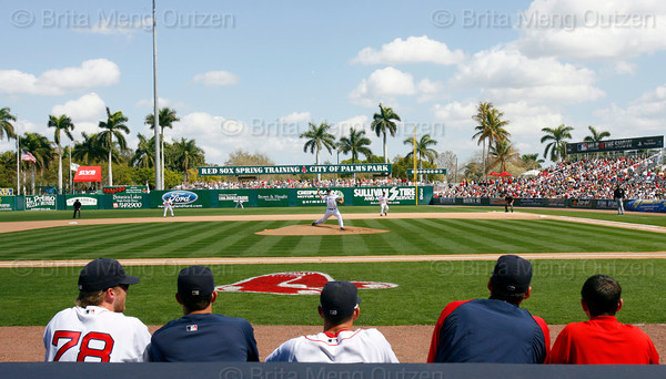 FORT MYERS, FL, March 13, 2010: Boston Red Sox players and coaches watch as Red Sox pitcher Jonathan Papelbon throws the baseball in the fourth inning of a spring training game against the Pittsburgh Pirates. (Brita Meng Outzen/Boston Red Sox)