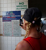 FORT MYERS, FL, March 25, 2011: A Boston Red Sox fan uses her cellphone to take a picture of the starting lineup for the game between the Red Sox and Toronto Blue Jays posted at City of Palms Park. (Brita Meng Outzen/Boston Red Sox)