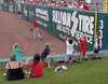 FORT MYERS, FL  March 8, 2011: A young fan sitting in the grassy berm catches the baseball thrown to him by Houston Astros right fielder Brian Bogusevic during the seventh inning. (Brita Meng Outzen/Boston Red Sox)