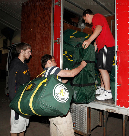 June 2, 2011, Boston, MA: Clubhouse workers unload the truck of Oakland A's equipment into the visiting clubhouse at Fenway Park. Photos taken at Fenway Park from 7 PM to 1 AM during a shoot for the 100 Years of Fenway Park book project. (Brita Meng Outzen/Boston Red Sox)