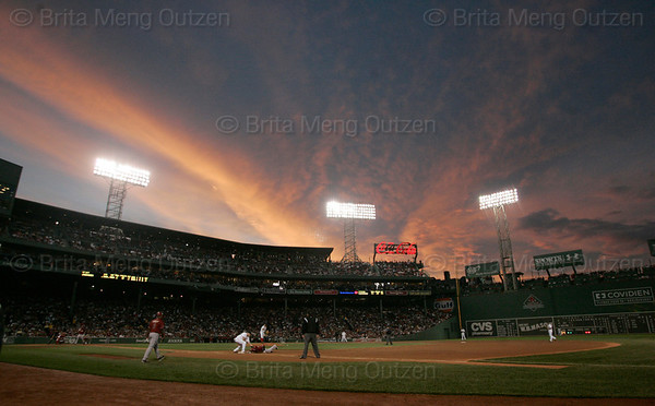 BOSTON, June 24, 2008: The sun sets over Fenway Park in the fourth inning as the Boston Red Sox play the Arizona Diamondbacks. (Brita Meng Outzen)