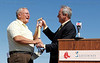 March 4, 2011, Fort Myers, Fla.: Boston Red Sox president and CEO Larry Lucchino (right) presents Lee County Board of County Commissioners chairman Frank Mann with a ceremonial shovel at the ceremony celebrating the construction of the new Red Sox Spring Training Ballpark and Player Development Complex in Fort Myers, Fla. (Brita Meng Outzen/Boston Red Sox)