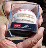 March 4, 2011, Fort Myers, Fla.: Lee County Board of Commissioners chairman Frank Mann holds a commemorative baseball celebrating the construction of the new Boston Red Sox Spring Training Ballpark and Player Development Complex in Fort Myers, Fla. (Brita Meng Outzen/Boston Red Sox)