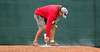 Feb. 25, 2011, Fort Myers, FL: A grounds crew member paints pitching rubbers in the bullpen area before Boston Red Sox spring training workouts. (Brita Meng Outzen/Boston Red Sox)
