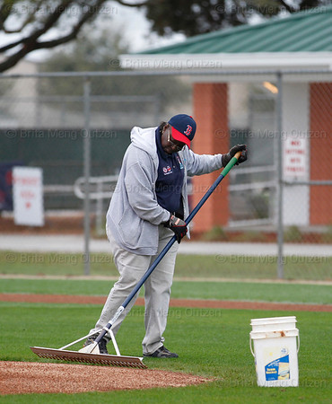 Feb. 25, 2011, Fort Myers, FL: A grounds crew member rakes the pitcher's mound on one practice field prior to Boston Red Sox spring training workouts at the player development complex on Edison Avenue. (Brita Meng Outzen/Boston Red Sox)