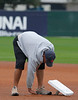 Feb. 25, 2011, Fort Myers, FL: A grounds crew member installs bases before Boston Red Sox spring training workouts at the standalone player development complex on Edison Avenue. (Brita Meng Outzen/Boston Red Sox)