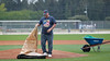 Feb. 25, 2011, Fort Myers, FL: A grounds crew member takes the cover off a pitcher's mound on a practice field at the Boston Red Sox player development complex on Edison Avenue. (Brita Meng Outzen/Boston Red Sox)