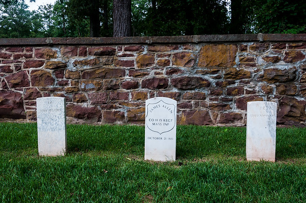Grave markers of the only known  soldier to fall at Ball's Bluff battlefield plus two unknown graves.