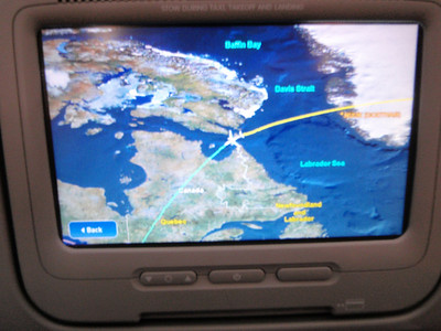 On the plane, with the flightplan in progress as we are over Canada