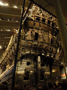 The aft of the ship is decorated with ornate carvings, including an image of the Swedish king being crowned as a boy.